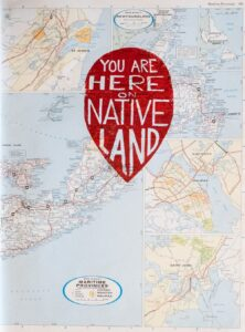 """background image of a map.  the focus of the image is a red pin point that reads """"you are here on Native land."""""""